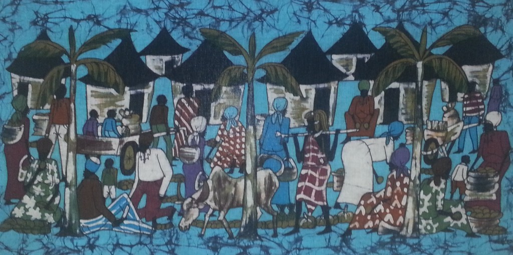 Images depicting an African village on a tapestry.