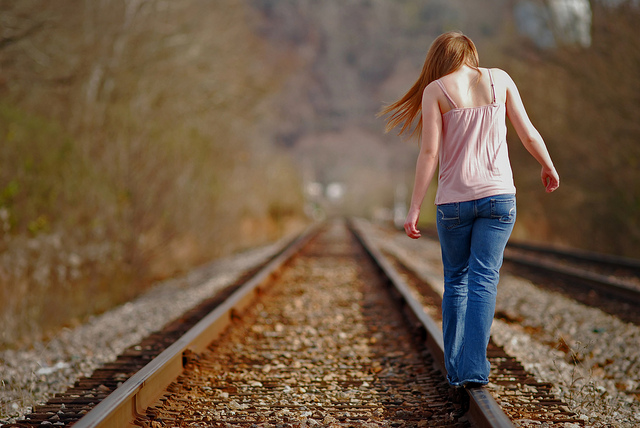 Girl on tracks.